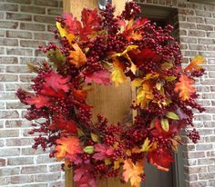 """- This Beautiful 24"""" Fall Wreath with Crimson Red Berries and a Mixture of Fall colored Leaves is a Weather Resistant Wreath that can be used Indoors or Outdoors - Sturdy Built Wreath on Grapevine Bas"""