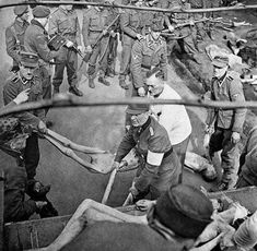 German guards forced to load the bodies of the people they murdered.