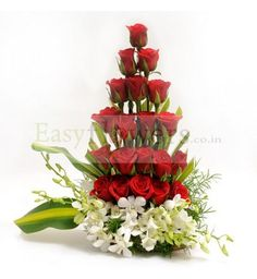 The perfect Valentine's Day gift: an elegant, graceful bouquet with red roses and white orchids. #LocalHyderabadFlorist