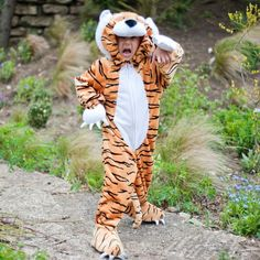 A plush tiger costume with feature hood that has furry whiskers and padded nose Complete with tail and fake soft claws This style has a front zip for