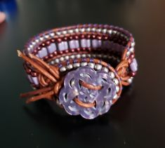 Czech glass tile beads, silver and burgundy seed beads handstitched on to antiqued brown leather cord. Faux abalone shell button enclosure in lilac. Leather Cord, Brown Leather, Suede Bracelet, Abalone Shell, Czech Glass, Hand Stitching, Jewelry Ideas, Seed Beads, Lilac