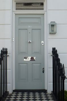 Farrow and Ball, Light Blue Front Door with shiny silver coloured door furniture