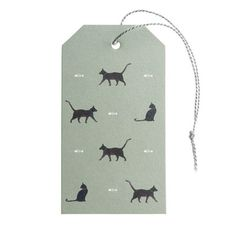 We think that wrapping up presents is just as much fun as opening them and our lovely range of Gift Tags will make that gift extra special!  These Cat Gift Tags come in a pack of ten with grey thread ties. The reverse of the tags has been left blank for your message.  These adorable gift tags feature six adorable black Cats and some white fish bones on a dark olive green background. Perfect if you're wrapping something up in our Cat Gift Wrap. Have a peek at the matching Ribbon options too!