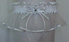Sheer Perfection. White sheer organza garter with a satin edge. A white satin bow with tails and a silver accent bow with a crystal rhinestone in the center. Sheer Elegance. Garters for Wedding - Bridal - Prom - Fashion. Style # Shr-029-White - #WinterWedding / Visit: www.garters.com/page42a.htm
