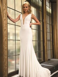 Sophisticated fitted gown with a darning neckline. Available in Off White, Red, Navy, and Black! #girligirlboutique #girligirl #formal