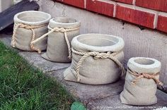 Pour concrete into heshen bags with a plastic pot inside to make cute planters for the garden!