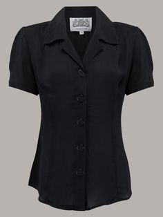 Another of our all time favourite blouses, this is a Classic 40's shape with a revere collar, large buttons to the front and short sleeves with tiny button detail on the cuff. The beautiful 40's Crepe de Chine fabric is soft to the touch and easy care too, and is a 100% natural fibre, no synthetic yarn or Lycra in any of our garments.