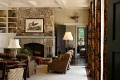 Great stone mantle . Classic look in the mountains by Meridy King Interiors