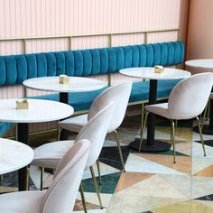 Meir Guri has used dusty pink and multicoloured marble tiles to ensure this restaurant stands out against its shopping centre setting in Tel Aviv.