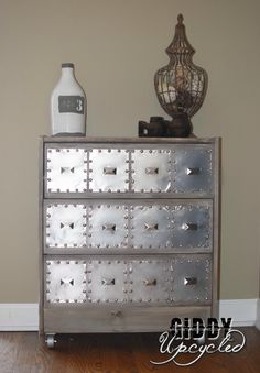 IKEA Rast Makeover to an Industrial Dresser using vinegar and black tea to stain it, aluminum craft squares, decorative nails, caster wheels, nickel finish knobs, white paint to white-wash it