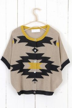 This is a very cool sweater even though it may not rock you at first. It would look fantastic with a long floateeee  skirt, pants, gauchos...even shorts.