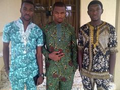 Nigerian men dressed in traditional attire.