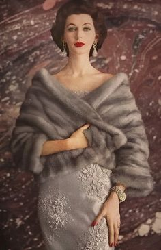 Dovima  Harper's Bazaar 1955. Super classy although I don't support all the animals that were used to make that cape..