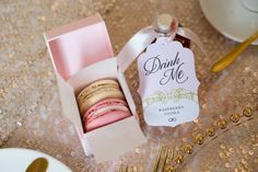 Wedding favours don't have to be dull and these Laduree Macarons and miniature cocktail prove just that. Positioned at wedding guests' places they finished off the wedding breakfast tables perfectly. Photography by http://dottiephotography.co.uk/