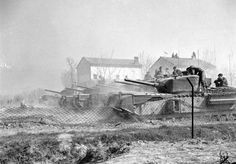 Churchill NA 75 tanks of the North Irish Horse lay down indirect fire on enemy positions in Italy, March 1945.