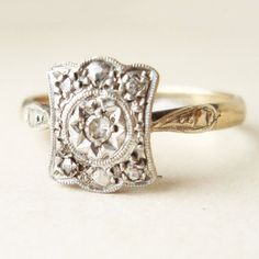 shameless plug for one of my favorite etsy shops. This beautiful ring is around 120 years old. I've already decided my engagement ring will come from this shop.