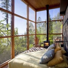 sunny bedroom with fireplace and a view, perfection
