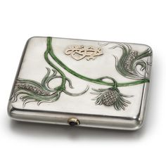 A Fabergé Silver, Enamel and Diamond-Set Cigarette Case, Moscow, circa 1900, of rounded rectangular shape, in the Art nouveau taste, the cover chased with stylized diamond-set pinecones and pineneedles enameled green, the cover also applied with a gold monogram, with gold-mounted cabochon sapphire pushpiece.