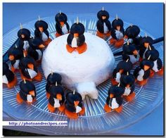 Just imagine a cute display of penguins, made with black olives, carrots and cream cheese! You can add scarves and hats by using fresh red pepper strips, or canned pimentos cut into different shape…