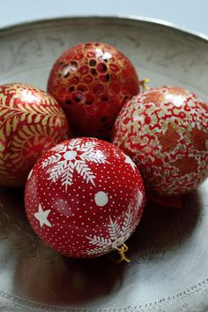 Four hand-painted baubles: Red Floral. Painted by fair trade artisans in Kashmir and available from Decorator's Notebook.