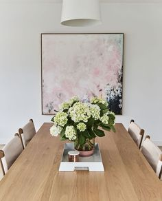 """""""Always Dreaming"""" by Michael Bond taking centre stage above dining table"""