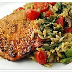 A Southeast Asian-style pesto made with Thai basil, mint, cilantro and fresh ginger makes a great flavoring for oven-roasted salmon and an accompanying warm salad of orzo, fresh tomatoes and baby spinach.