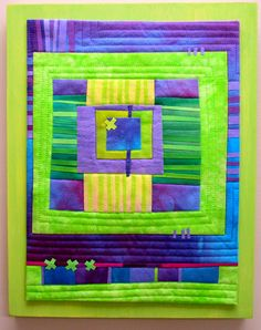 Delphinium Patch Hand dyed cottons, fused, machine quilted, mounted on painted wood panel. 11x14""