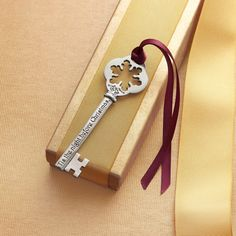 "SANTA'S KEY BUBBLE WAND -- Introduce a Christmas Eve tradition of blowing bubbles filled with good thoughts into the world. At bedtime, hang the key on your door to save Santa a trip down the chimney. Gift box includes bubble recipe. Hand cast in USA of pewter. Key 4""L."