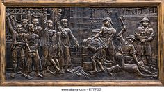 Bas-relief in Hoa Lo Prison depicting brutal treatment by French. - Stock Image