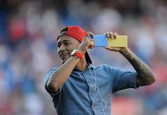 Neymar of Barcelona takes a photograph with his smartphone ahead of the Copa del Rey Final between Barcelona and Sevilla at…