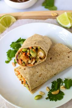 Asian Chicken Wraps with Thai Peanut Sauce. An easy, healthy recipe with edamame, carrots, and broccoli slaw