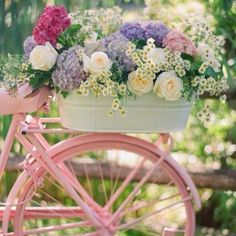 Bicycle flowers!! Sister has this in her front yard. Love the painted bike. That makes it.