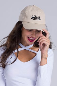 A baseball cap in 100% cotton twill is finished with letter embroidery.