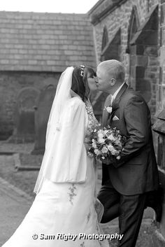 Bride & Groom share a kiss