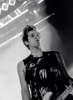 Luke Hemmings the 10 ft tall man-boy with the 10 ft tall hair.