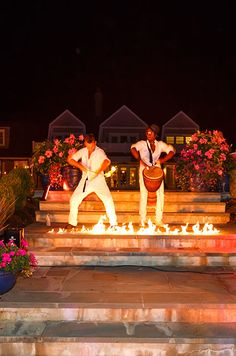 A flame thrower and drummer heat up the night by leading guests into the reception area.