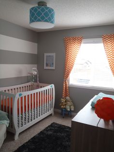 Baby A's nursery as featured on Project Nursery with a Monza II 2-in-1 Crib in white by #Storkcraft.