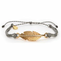 Put a hint of glam on your wrist with the Leaf Pura Vida bracelet. With a pristine grey handmade twist bracelet that features a gold leaf piece and adjustable pull strings for custom wrist sizing, you just can't go wrong. There is even a small gold P char