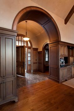 Craftsman entry with beautiful wood-work and archways. #entryway #foyer homechanneltv.com