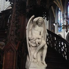 A marble Lucifer hides behind the pulpit of this Gothic cathedral.