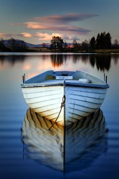 The eternal calm of strife. Front view of a boat on a lake at sunset, in Scotland. Photo by David Mould on Pretty Pictures, Cool Photos, Beautiful World, Beautiful Places, Landscape Photography, Nature Photography, Foto Picture, Boat Art, Jolie Photo