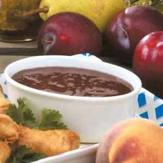 Spicy Plum Sauce Recipe with onion, garlic, cider vinegar, ginger, mustard, cinnamon, red pepper flakes, and cloves