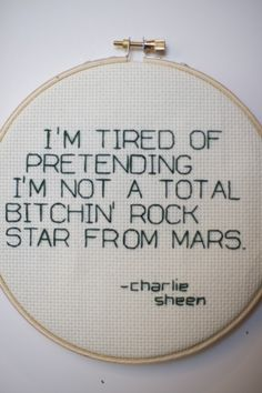 """""""Let the world know you're winning.  This is a 6'' wooden hoop with the stitched with a Charlie Sheen quote in green thread on natural aida fabric.   Makes a great gift for yourself or one of your Goddesses.  Can be hung on a wall or placed on a shelf. """""""