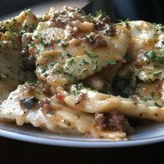 """Easy Mouthwatering Baked Ravioli   """"Add a few fresh ingredients to a bag of frozen ravioli and serve up an Italian-inspired dinner in a jiffy. The casserole has layers like lasagna, but is easy to put together."""""""