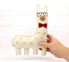 This listing is for a felt llama stuffed animal hand sewing pattern. ~~~o~~~o~~~o~~~o~~~o~~~o~~~o~~~ • This is a DIGITAL DOWNLOAD, not a PHYSICAL PRODUCT. You will not receive anything in the mail / by post. • You are welcome to sell personally-made finished products made from my
