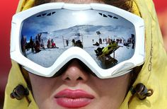 Iranian skiers are reflected in the goggles of a skier at Dizin Ski Resort, 45 miles (72 kilometers) north of the capital Tehran, Iran, on January 15, 2016. Every weekend, the resort in the Alborz mountain range, north of Tehran, draws hundreds of skiers from the capital and other towns.