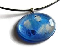 Hand painted blue and silver paint swirl oval by ClarityArtJewelry