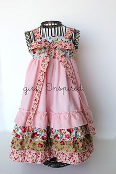 Tea Time Knot Dress -- The straps of the dress are secured in the back, slide through buttonholes on the front of the bodice, and tie into a full bow in the front.