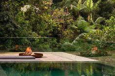 Architecture design maestro Studio MK27 has designed and built a stunning apartment, nestled in the dense jungle of the Brazilian rain forest.