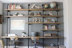 Home office and desk area with homemade wood/pipe shelves. Wood And Pipe Shelves, Pipe Shelving, Wall Shelving, Shelving Ideas, Shelving Units, Wood Shelf, Wooden Shelves, Iron Pipe Shelves, Plumbing Pipe Shelves